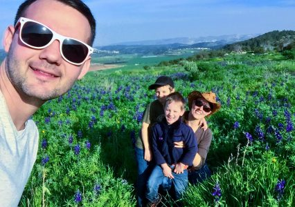 Christian and family at Socoh near Elah Valley with blooming flowers