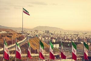 Row of Iran Flags in Front of Tehran Skyline